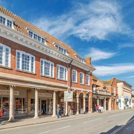 A photo of Farnham Town Hall Exchange in a walks distance of Brightwells Yard apartments for sale.