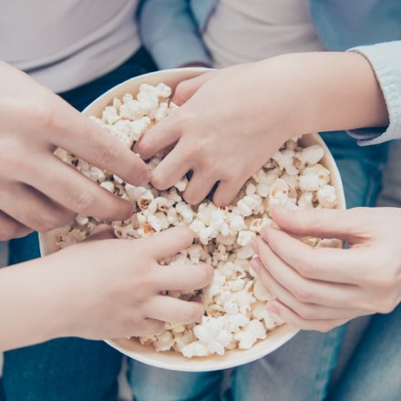 An abstract image of people eating popcorn. The new built apartments in Farnham will be a perfect place for families.